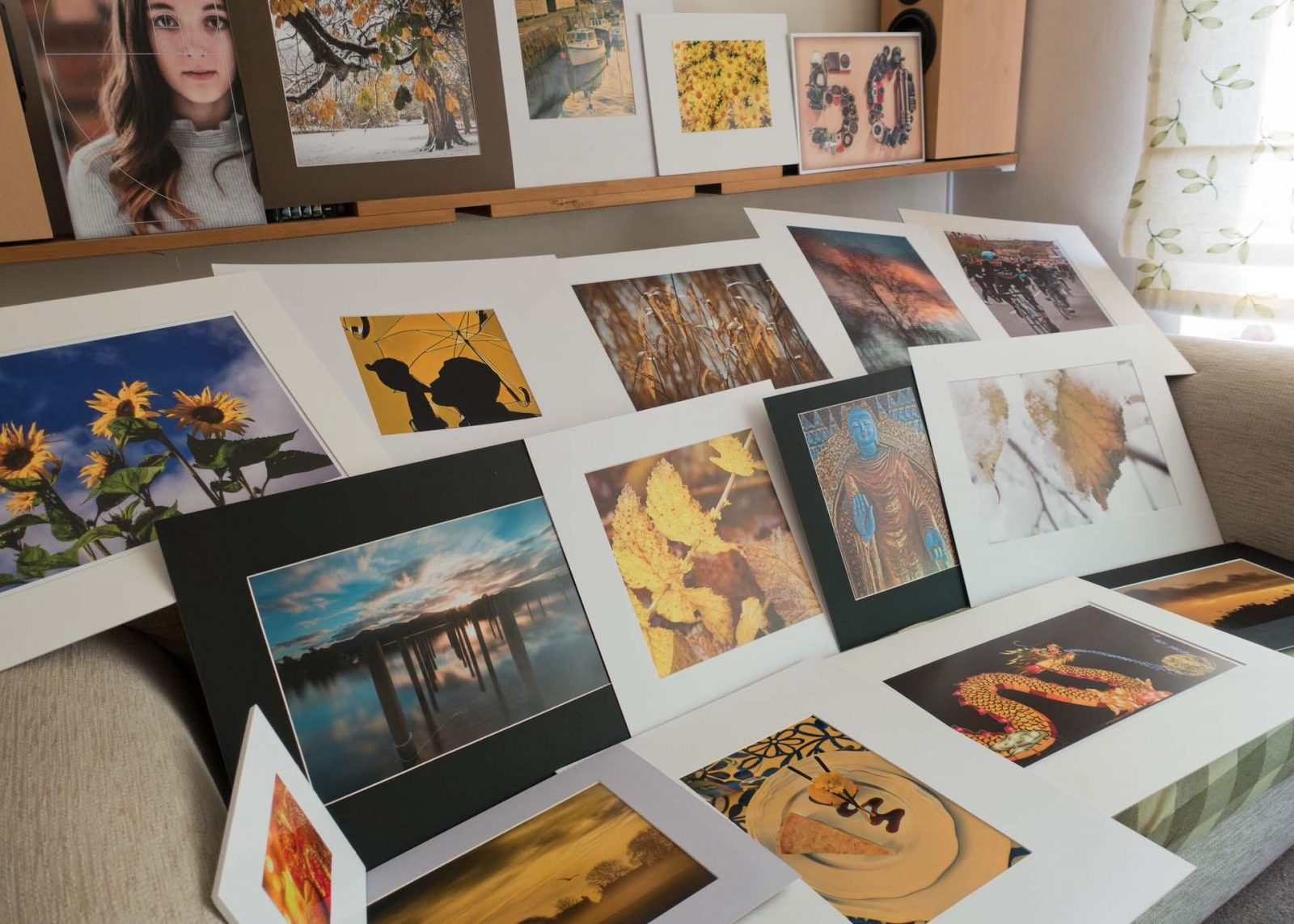 Find your niche as a photographer. There is no need to master every type of photography genre but use what inspires you and the local demand to specialize. Define and Master your Photography Niche on Falcondale Life blog. Image description: A variety of photo prints.