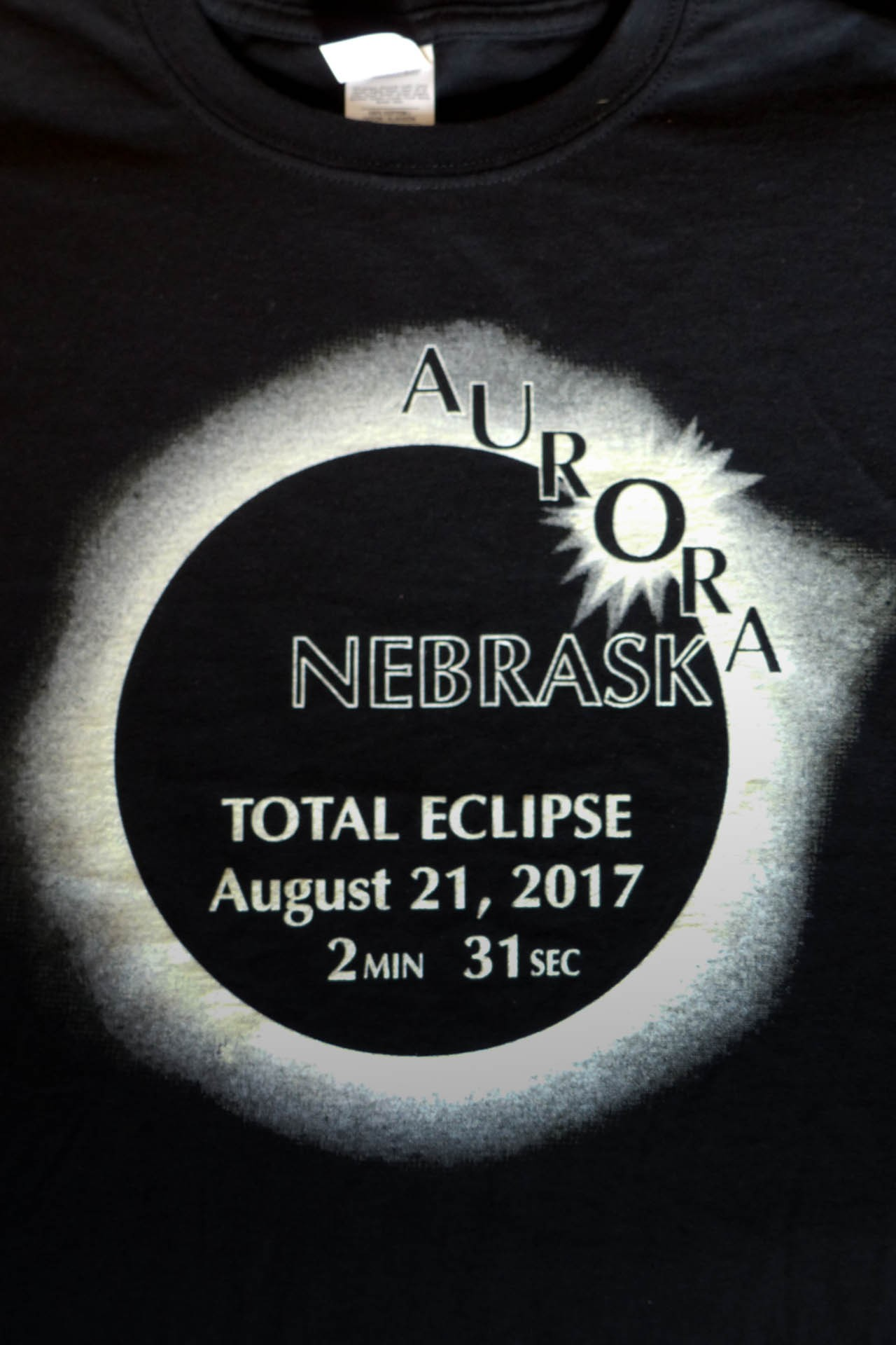 Story and photos of our family trip to see totality of the 2017 solar eclipse, Nebraska USA. How we did vacation planning, eclipse chasing and camera setup. Eclipse souvenir t-shirt.