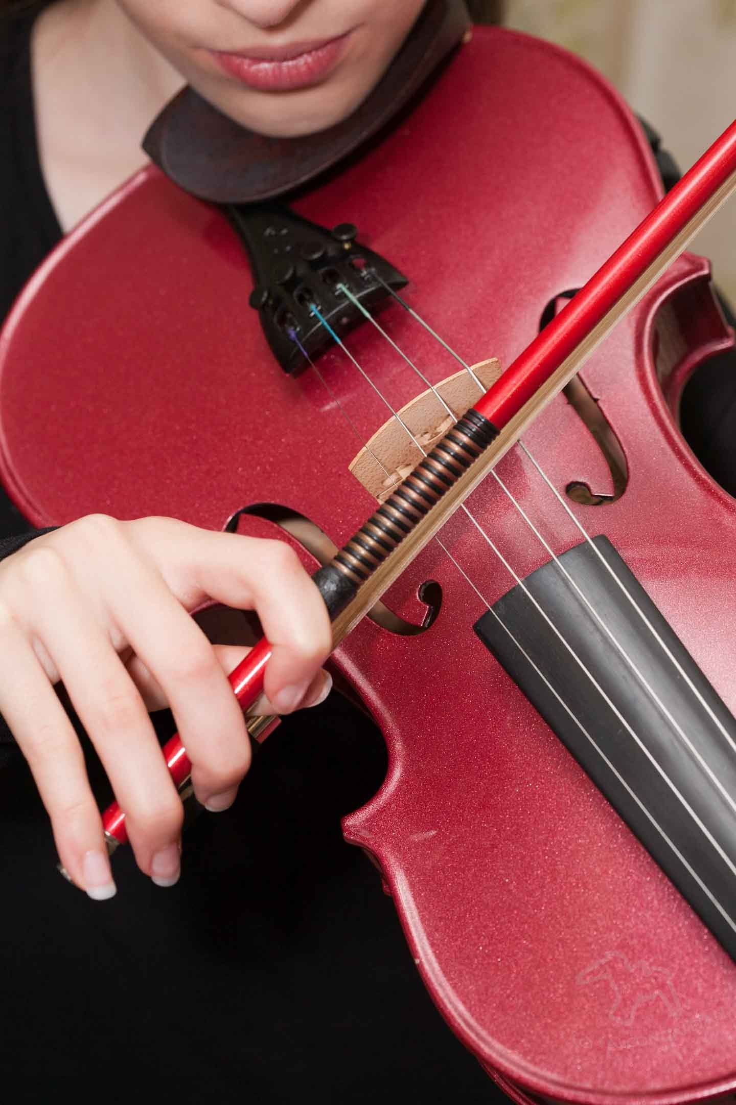 Six Stages of Kids Learning a Musical Instrument on Falcondale Life blog. Different stages for parents when helping a child with their musical instrument learning. From first lessons through orchestras and exams to teenage years.. Child playing the violin.