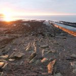 Clevedon seashore in Somerset, Pic of the Week on Falcondale Life blog. The winter sunset picks out the rocks on the foreshore in warm light.
