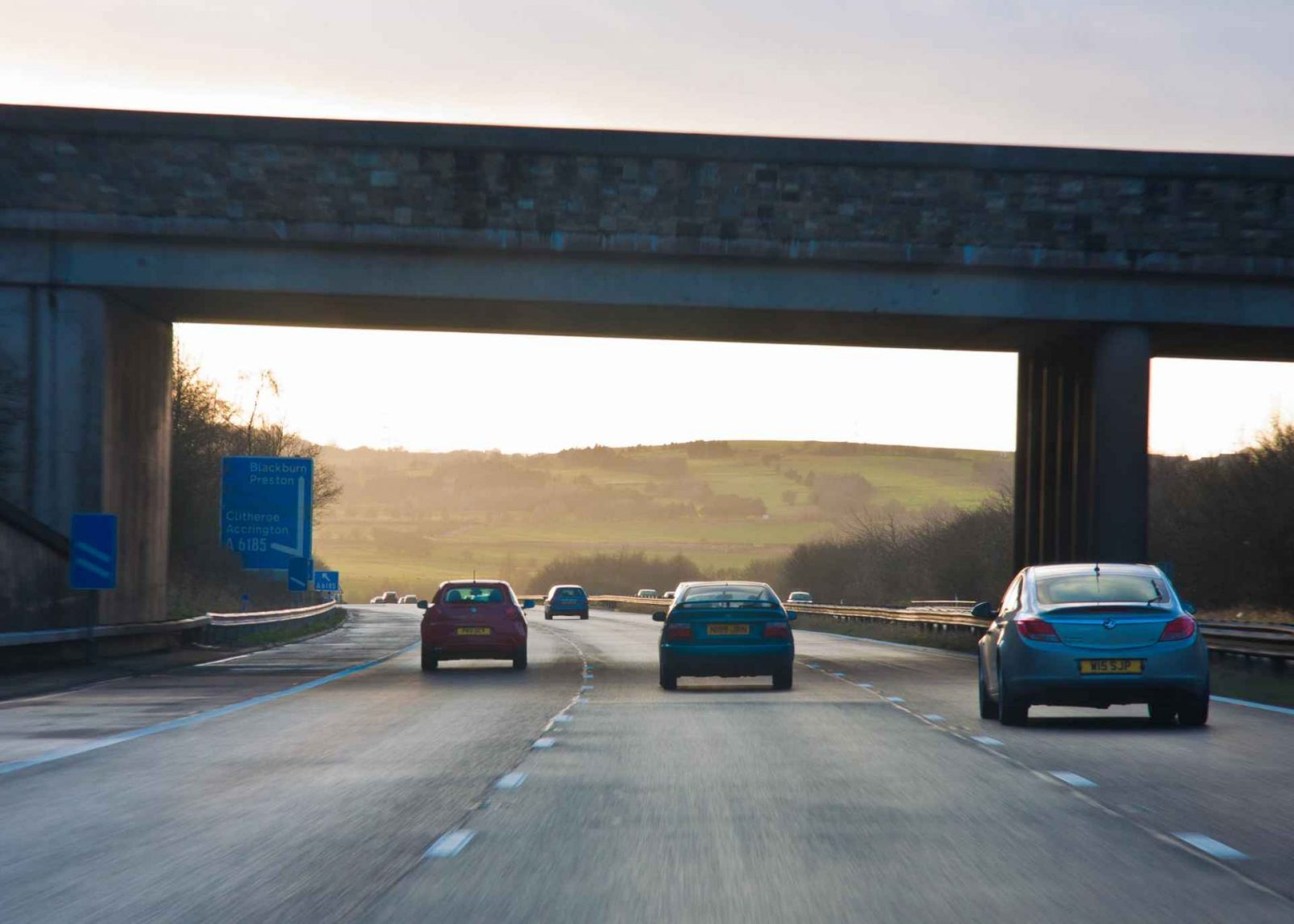 Is Now the Time to Buy an Electric Car? on Falcondale Life blog. Electric cars are here but how are manufacturers going to bring us more choice? What are the pros and cons of owning an electric car and will I be able to charge it? Insider tips and owner opinion. Motorway driving image.