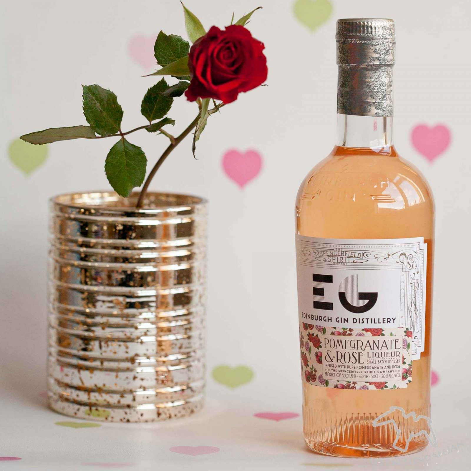 Edinburgh Gin Distillery Pomegranate and Rose Liqueur with a rose and hearts. Boozy Valentine's Gift Guide and Drinks Review on Falcondale Life blog. Unusual alcohol and gifts for drinkers on Valentine's day. Get something for him or her which is more interesting that just chocolate and wine. On test: Liqueurs, whisky, brewing kit, drinking game. Boozy gifts reviewed by FalcondaleJan.