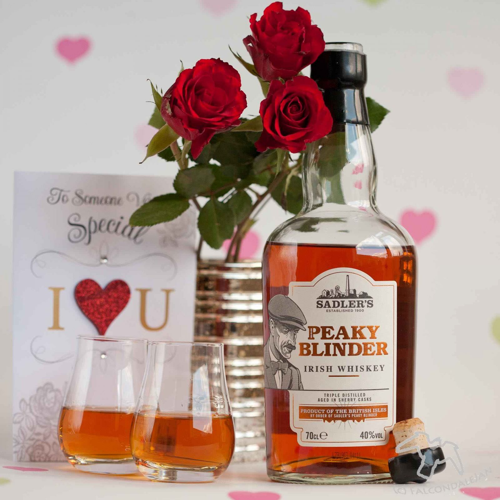 Peaky Blinder Irish Whiskey in glasses with a Valentine's card and roses. Boozy Valentine's Gift Guide and Drinks Review on Falcondale Life blog. Unusual alcohol and gifts for drinkers on Valentine's day. Get something for him or her which is more interesting that just chocolate and wine. On test: Liqueurs, whisky, brewing kit, drinking game. Boozy gifts reviewed by FalcondaleJan.