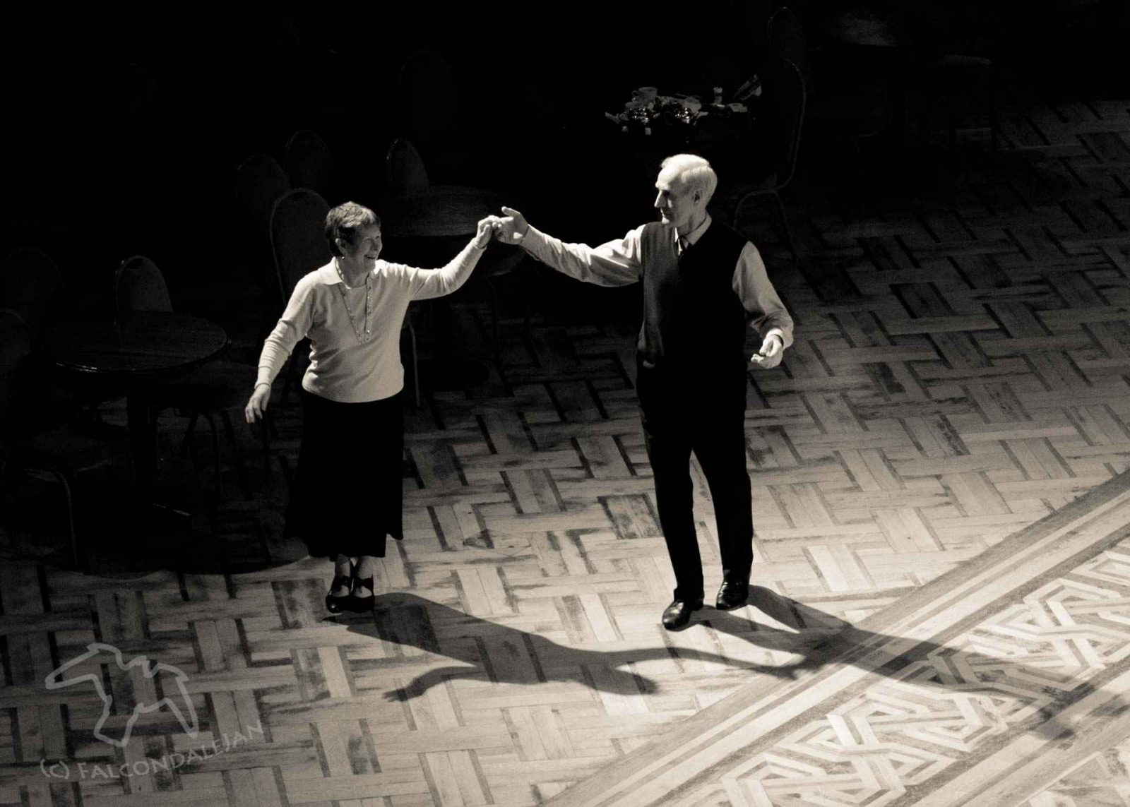 A couple on the dancefloor at Blackpool Tower Ballroom, a dramatic image in black and white. A blog series about monochrome photography. Here's how I decide when to turn a photo from colour to black and white. The reason may be anything from finding real beauty in the image to saving it from the bin. First in the blog series is the high contrast photo. By Falcondalejan.