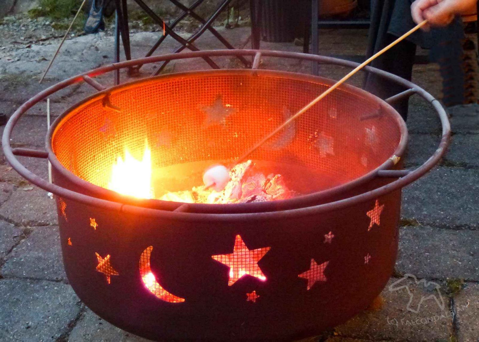 Toasting marshmallows over a garden fire pit. 5 ways to get your teenagers into the garden on Falcondale Life blog.