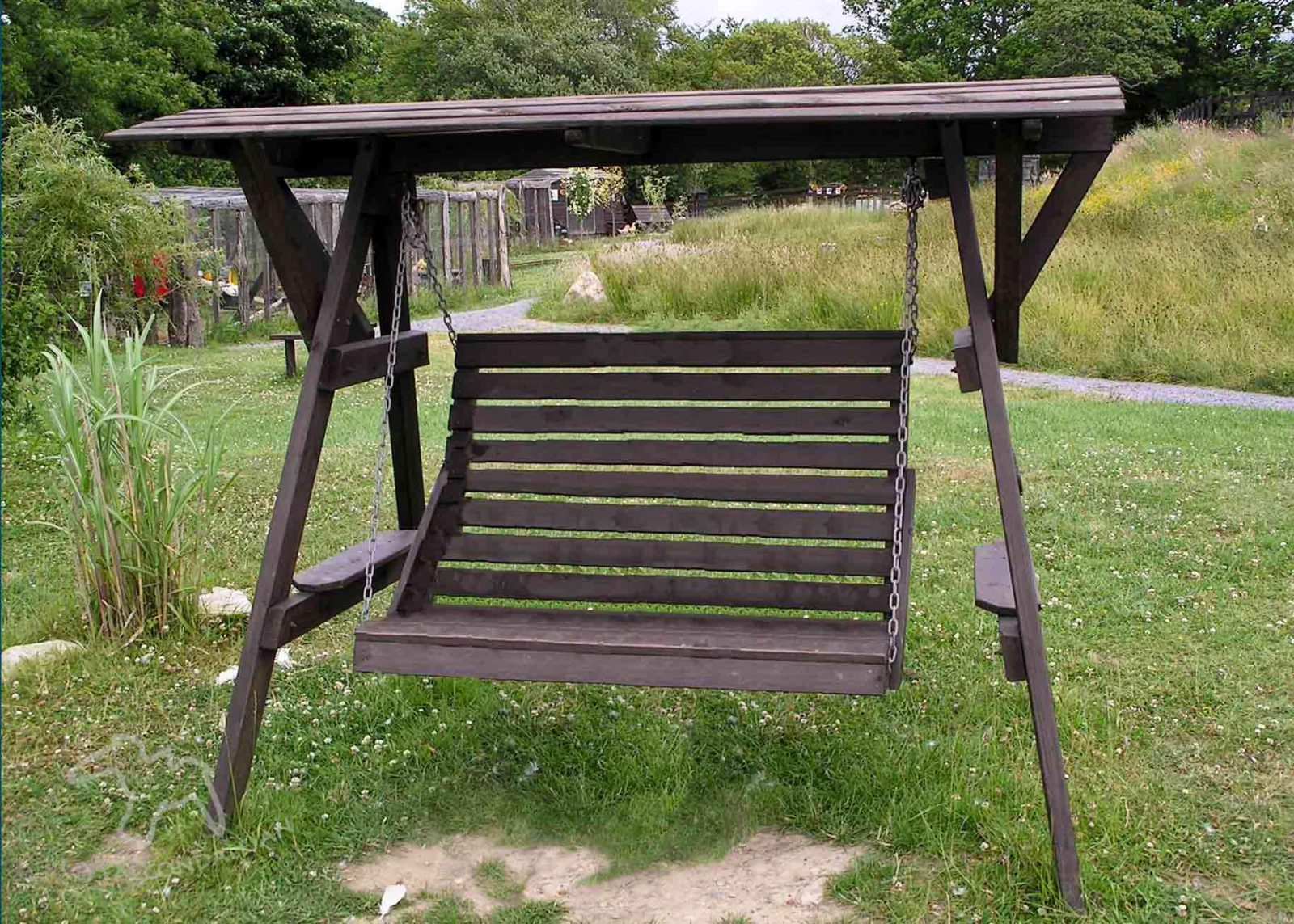 Garden swing seat for two made of wood with canopy. 5 ways to get your teenagers into the garden on Falcondale Life blog.
