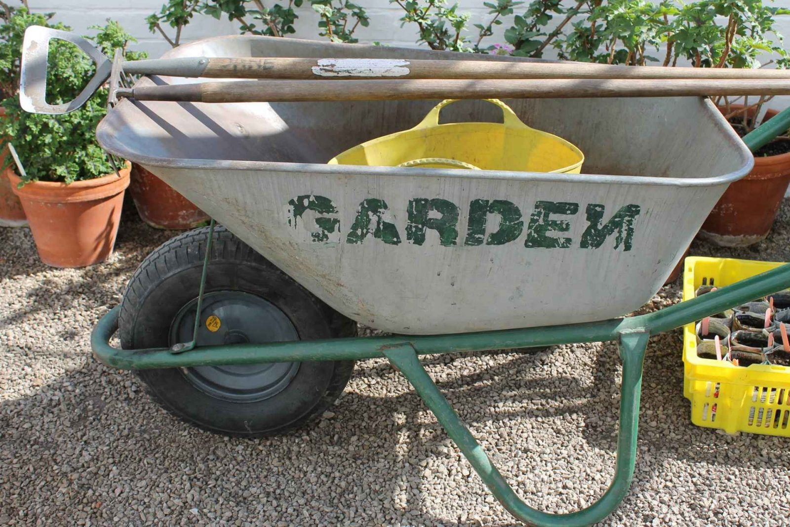Wheelbarrow, hoe and garden tools. 5 ways to get teenagers to enjoy the garden on Falcondale Life blog.