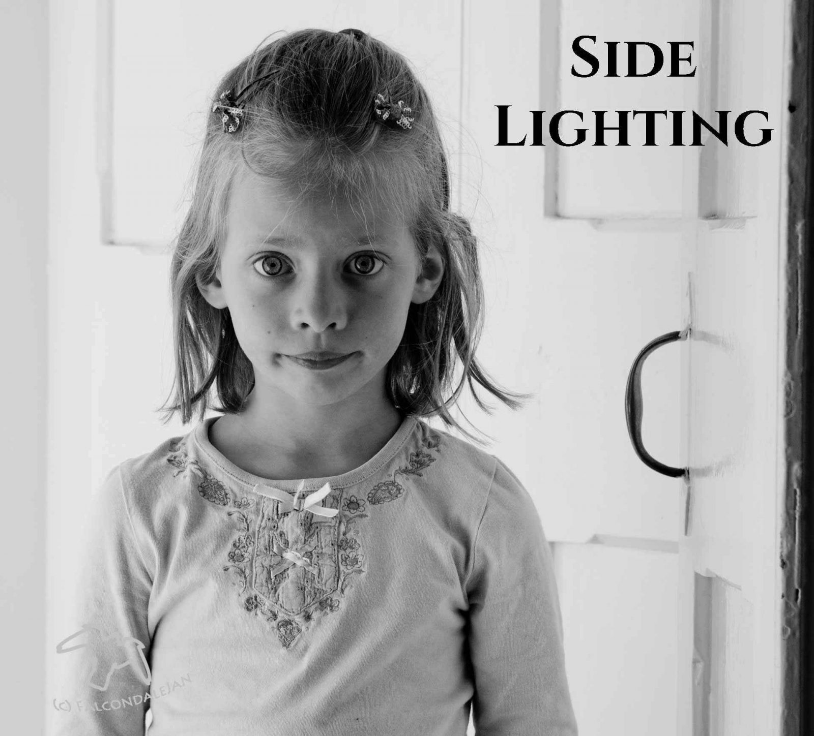 Reasons to shoot black and white part 5, Flattering portraits. More reasons to choose black and white in photography, this time to make more flattering portraits by using monochrome. Flatter skin tone and make a timeless and enduring image by switching to a black and white photo. Tips from Falcondalejan. Image description: little girl portrait, side lighting.