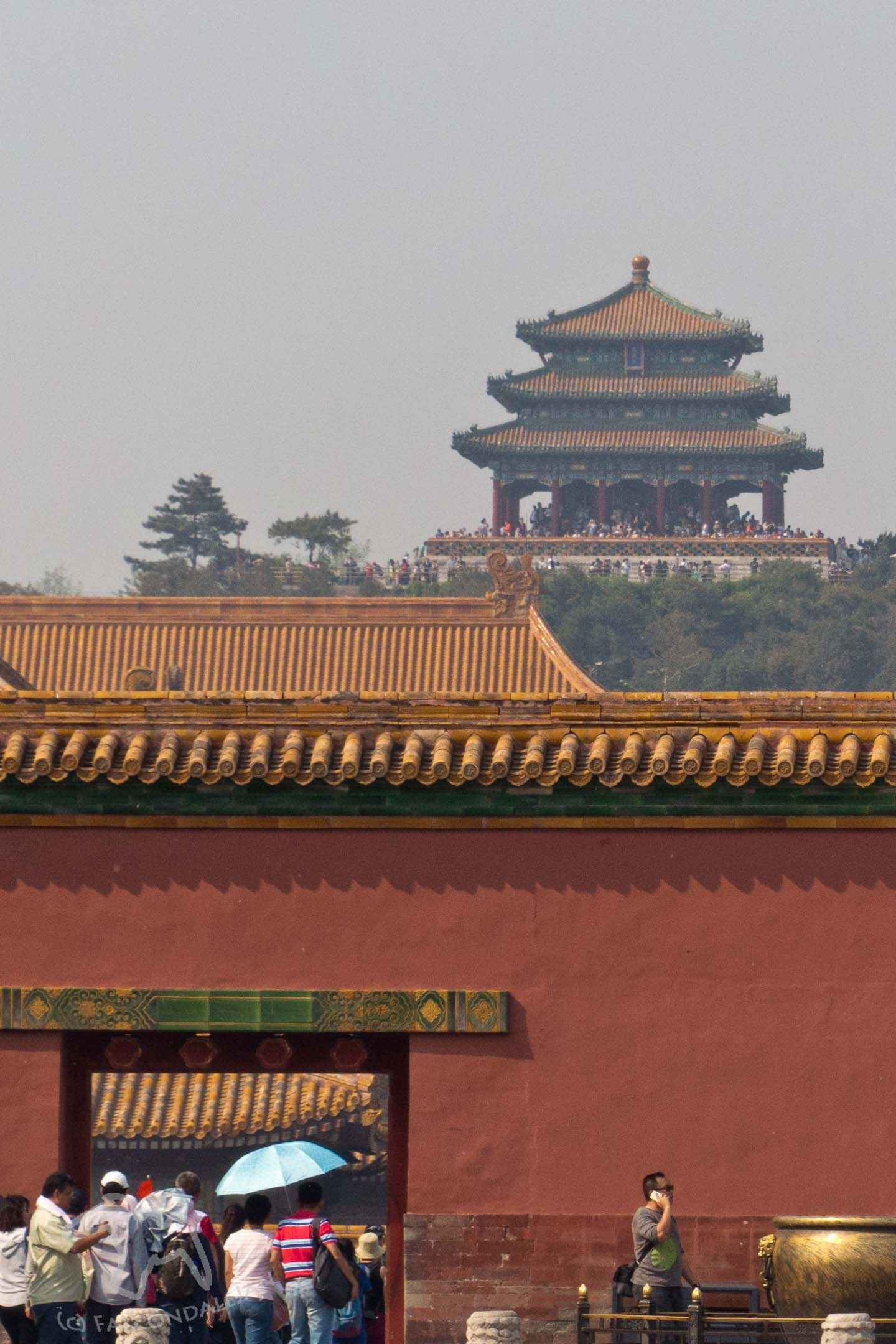 How to spend a day off from business travel in China, what can you fit in to one day in Beijing? Ideas to visit the sights, attractions and experiences with tips to take better photographs. Visit the Forbidden City. You may leave the city with a wish to come back for a proper holiday. Image description: Jingshan Park seen from The Forbidden City