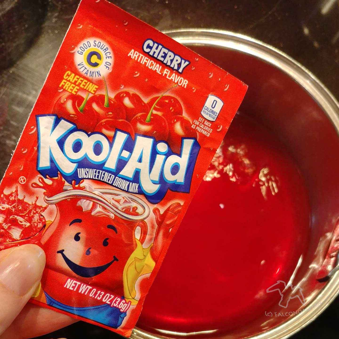 Is it safe to dye children's hair, and should parents agree to it? When your teen or tween wants hair dye here are points about safety and school rules. Things to consider when your teen or tween wants hair dye on Falcondale Life blog. Image description: pan of kool aid