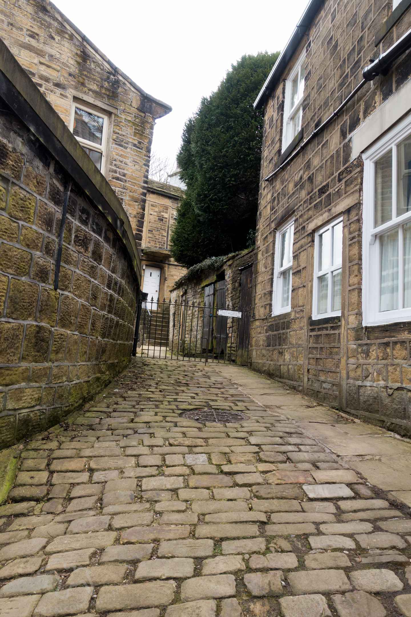 Unusual tips and hacks for independent itinerary planning for family holidays. Find ideas for road trips and self catering vacations that others may miss. Itinerary planning for families - hacks and tips for independent travel on Falcondale Life blog. Image description: cobbled English street, Haworth.