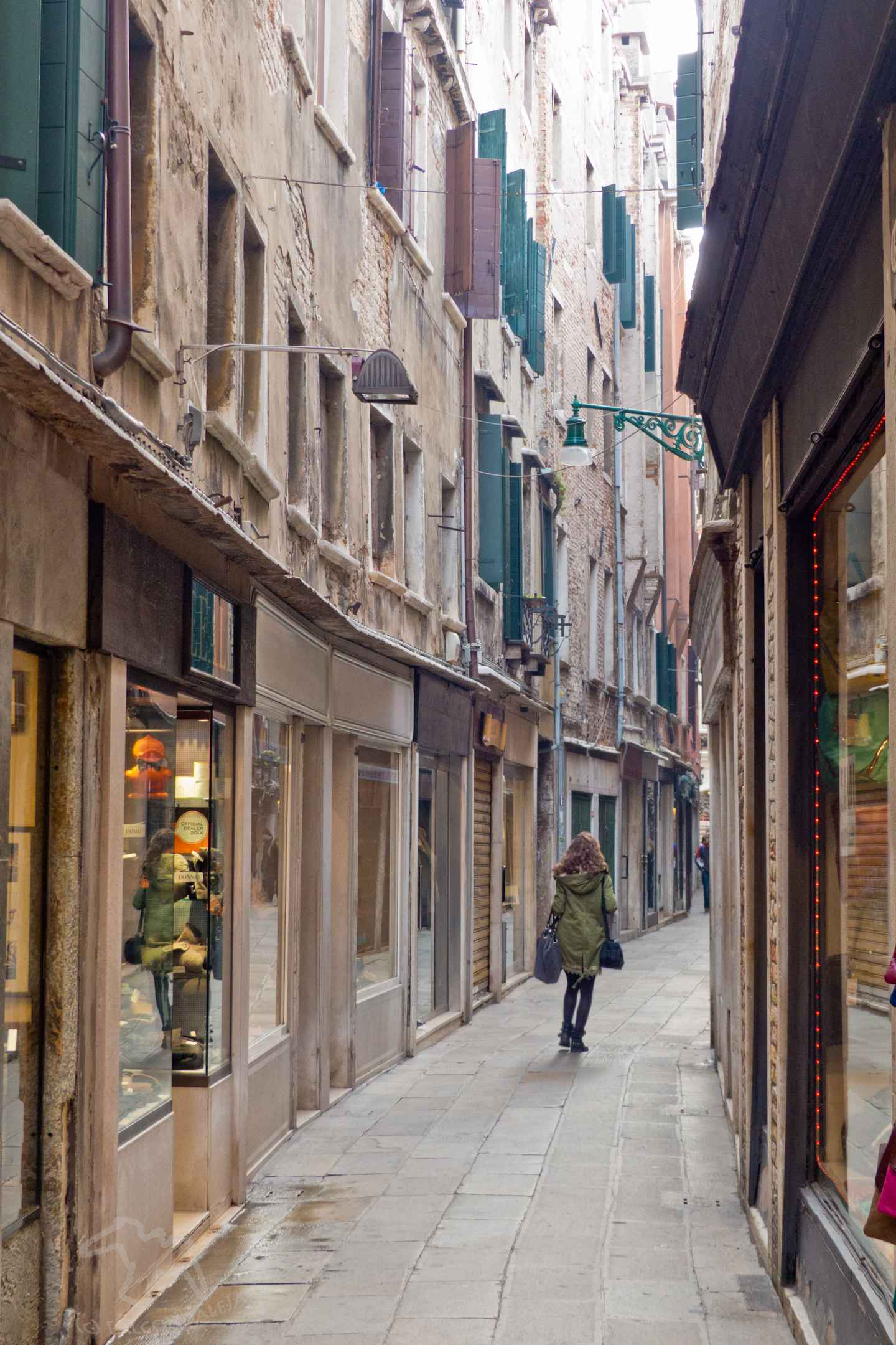 Can parents find romance in Venice with kids in tow or is it best to go without the children? Tips for Mums and Dads visiting the world's most romantic city. Plan a romantic trip to Venice with kids in tow on Falcondale Life blog. Image description: Venice paved street.