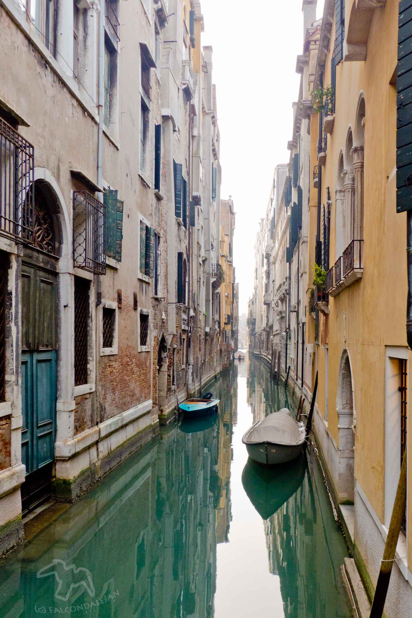 Can parents find romance in Venice with kids in tow or is it best to go without the children? Tips for Mums and Dads visiting the world's most romantic city. Plan a romantic trip to Venice with kids in tow on Falcondale Life blog. Image description: small canal in Venice